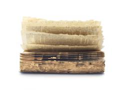Old book ruined by termite on white background Stock Photos