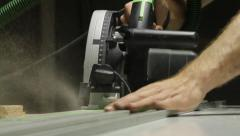 Worker sawing a piece of plastic Stock Footage