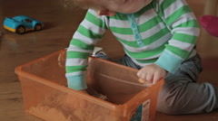 A cute little blond boy play with kinetic sand - stock footage