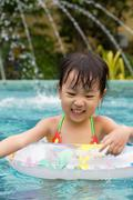 Asian Little Chinese Girl Playing in Swimming Pool - stock photo
