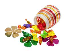 Chocolates in colorful wrappers Stock Photos