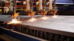 Four plasma cutters cutting steel Stock Footage