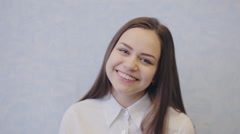 Cute young teen girl smiling Stock Footage