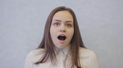 Cute girl is surprised, astonished Stock Footage