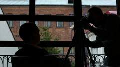 The photographer working with a model in a rich interior. - stock footage