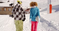 Young couple in a winter ski resort - stock footage