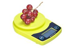 bunch red seedless crimson grape on electronic kitchen scale - stock photo