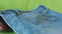Brown boots and blue denim jean on isolated green screen Stock Footage