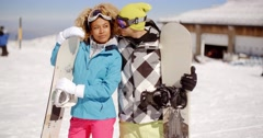 Affectionate young couple posing with snowboards - stock footage