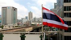 Train arriving at the station with a waving flag of Thailand Stock Footage
