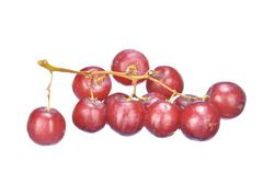 Delicious bunch red seedless crimson grape isolated on white Stock Photos