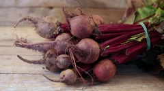 Fresh organic beets just picked from the garden on an old wooden table. Stock Footage
