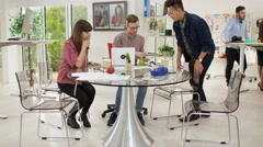4K Time lapse of busy creative design team at work in modern office Stock Footage