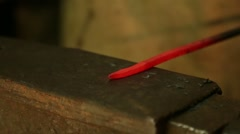 Farrier hammers on the red-hot piece of iron Stock Footage