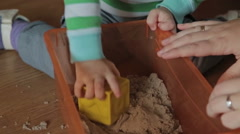 A cute little blond boy play with kinetic sand Stock Footage