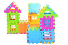 Stock Photo of Multi color building pieces block create house isolated on white background