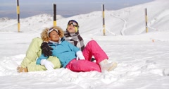 Affectionate young couple enjoying the fresh snow - stock footage