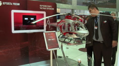 Model helicopter Mi34C1 and visitors at the stand. Stock Footage