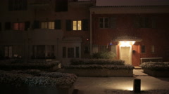 Establishing shot of exterior of a house and windows, snowing outside Stock Footage