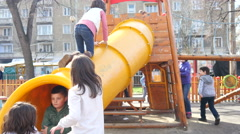 Kids have fun playing on a big playground outdoors in Sofia Bulgaria Stock Footage