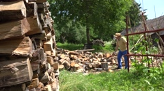 Farmer chop wood with axe and drink water tired hard work. 4K Stock Footage