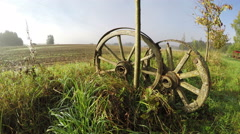 Two wooden wheels on misty autumn's morning, time lapse 4K Stock Footage