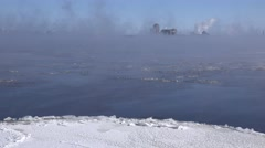 A river in the winter time with mist rising over rushing water. Stock Footage
