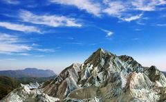 Rock mountain under cloud blue sky - stock illustration
