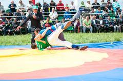 Stock Photo of Orenburg, Russia - 7 June 2015: Wrestling on belts or Koresh