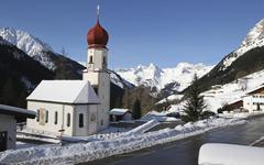 Pilgrimage church Maria Schnee in winter in Lech valley with view to the - stock photo