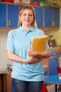 Childcare Worker Standing In Nursery - stock photo