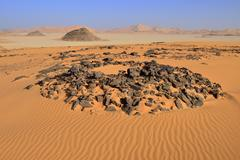Tumulus burial mound in the sanddunes of Oued In Djerane Tadrart Tassili n´ - stock photo