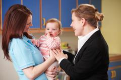 Working Mother Dropping Child At Nursery - stock photo