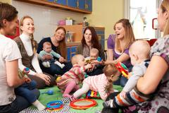 Group Of Mothers With Babies At Playgroup Stock Photos