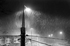 Blizzard, street lamp, night Stock Photos