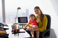 Portrait Mother Business Woman Playing Child At Work - stock photo