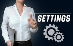 Settings touchscreen is operated by businesswoman Stock Photos