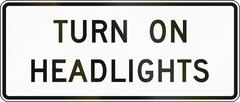 United States MUTCD road sign - Turn on headlights - stock illustration