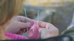 Knitting socks for granddaughter - stock footage