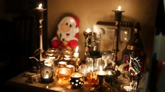 Burning candle with santa claus, christmas decoration - stock footage