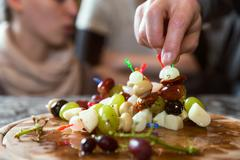plate with party snacks - stock photo