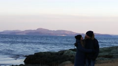 The couple have fun near fjord, trondheim, Norway Stock Footage