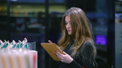 Girl selecting products from the list - stock footage