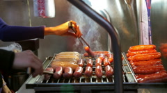 Vendors grilling Taiwanese bbq sausages. Delicious food of Taiwan Stock Footage