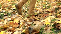 Slowmotion detail of woman´s legs which runs in woods Stock Footage