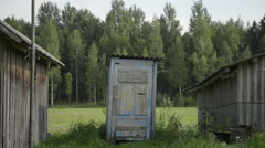 Old blue toilet in countryside Stock Footage