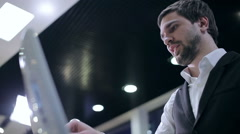 Businessman using touch panel for order Stock Footage