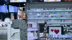 Pretty girl shopping in supermarket Stock Footage
