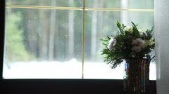 A bouquet in a vase on the window Stock Footage