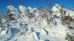 On top of the mountain Caps among the jagged rocks on a clear winter day Stock Footage